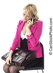 Model Released. Attractive Young Woman With a Briefcase Using Mobile Telephone