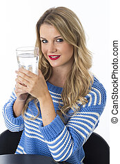 Model Released. Attractive Young Woman with a Glass of Water