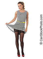 b245c932081 Model released. sexy young woman raising skirt showing stocking tops.