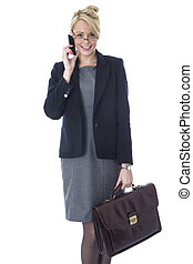 Model Released. Young Business Woman Holding a Briefcase Talking on Mobile Telephone