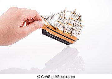 Model Sailboat and hand
