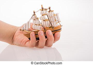 Model Sailboat in hand