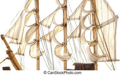 Model sailboat on white background. - Souvenir model of a...