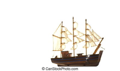 Model sailboat on white background. - Souvenir model of a...