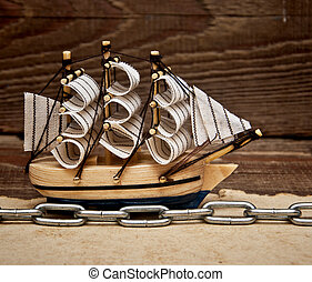 model ship on wood background