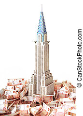 """Model skyscraper """"Chrysler Building"""" on the background Russian banknotes"""