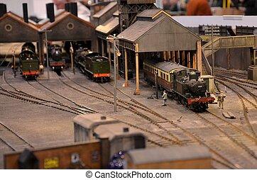 Model train engine at siding shed - Four miniature railway ...