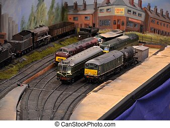 Model train engines parked on rails