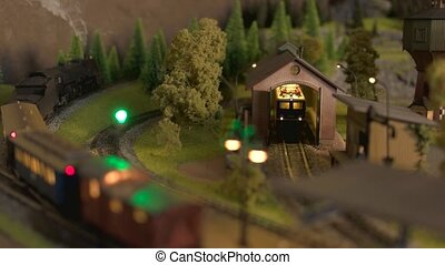 Model train station at miniature forest.