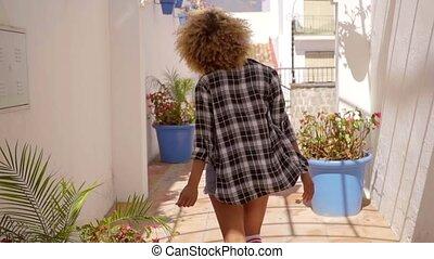 Model Walks The Mediterranean Backyard Along - Young sexy...
