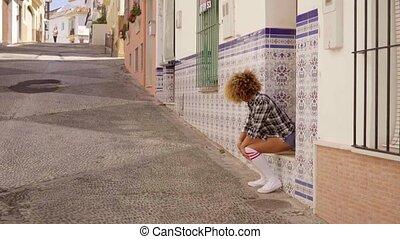 Model Walks The Mediterranean Street Alone - Young woman...