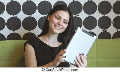 Model watching photos with a computer tablet