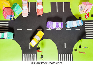 Model with crosswalks, signs, parking and toy cars