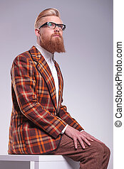 relaxed male model with long beard and glasses looking up to his side