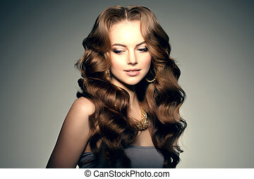 Model with long hair. Waves Curls Hairstyle. Hair Salon....