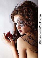 model with skew bodyart - portrait of beautiful model with...