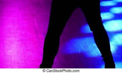 Model woman dancing at disco.