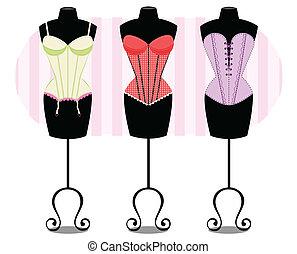 Ilustracao de manequins vestidos com corsets.