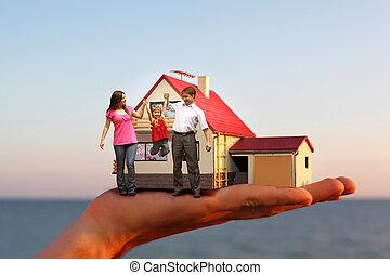 modello casa, con, garage, su, mano, contro, mare, e, famiglia, con, ragazza, collage