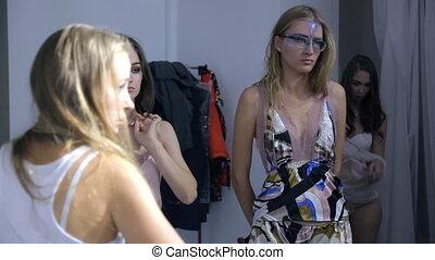 Models in lingerie at photo shoot inside studio waiting for order