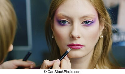 Models to apply makeup in the beauty salon