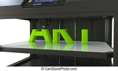 Modern 3D printer in action. Printing green ART caption,...