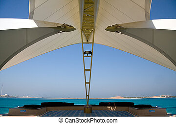 Modern Abu Dhabi structure framing sea and island - Modern...