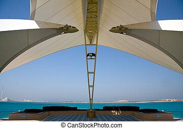 Modern Abu Dhabi structure framing sea and island - Modern...