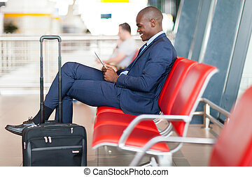 modern african businessman using tablet