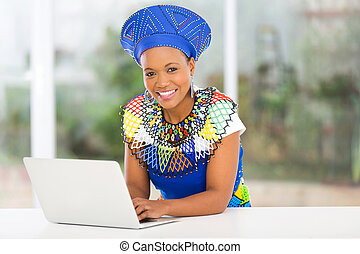 african zulu woman with laptop computer