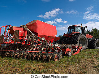 Modern agricultural machinery seeding machine hooked to a ...