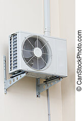 Modern air conditioner hanging on wall.