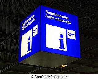 Modern airport flight information sign, selective focus