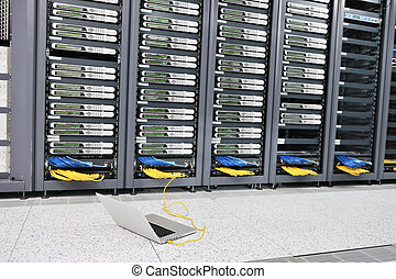 laptop computer at server network room - modern aluminium...
