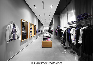 modern and fashion clothes store - interior of brand new ...