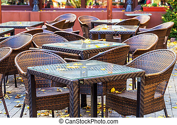 Modern and simple interior of the cafe with rattan furniture in autumn day