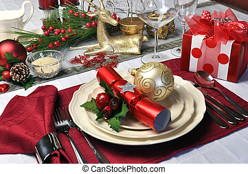 Modern and stylish Christmas dinner table setting including...