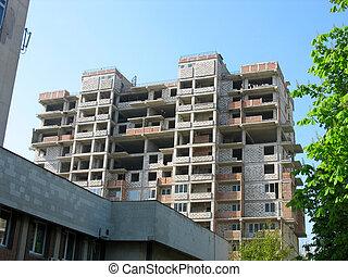 Modern apartment brick house under construction