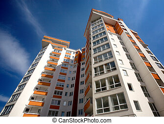 Modern apartment building against blue sky background
