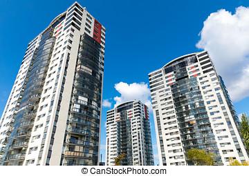 modern apartment buildings against blue sky