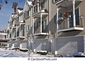 Modern Apartment Facade with Balconies and Garage Doors