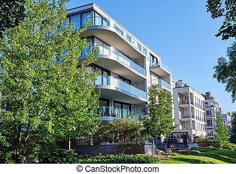 Modern apartment house with a green garden