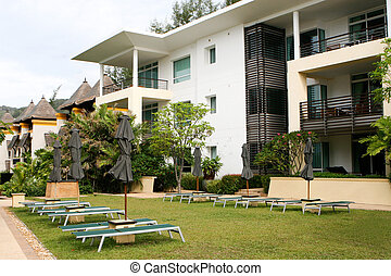 Modern apartments. - Exterior of a modern home and garden.