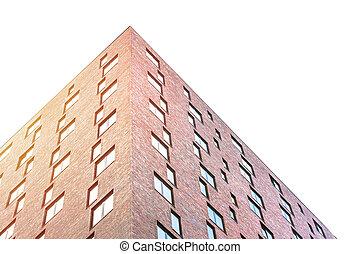 Brick skyscraper with many windows