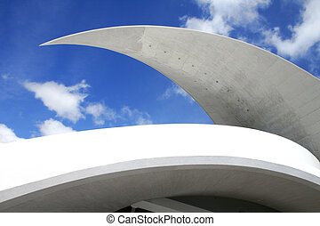 Close upof modern architectural structure with blue sky behind