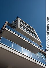 modern architecture from public road before blue sky in...