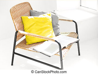 Modern armchair with cushions in living room