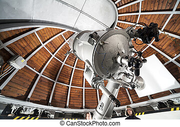 Modern astronomy telescope in an astronomical observatory...