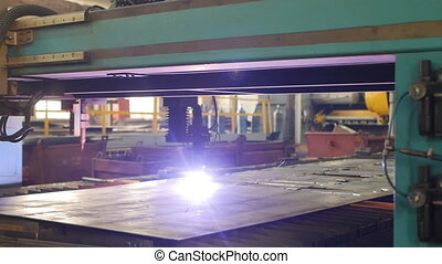 Modern automatic plasma cutting of metal by laser in...