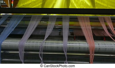 modern automatic spinning machine - weaving loom at a...